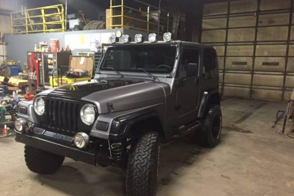 Black Car Wrap on a Jeep