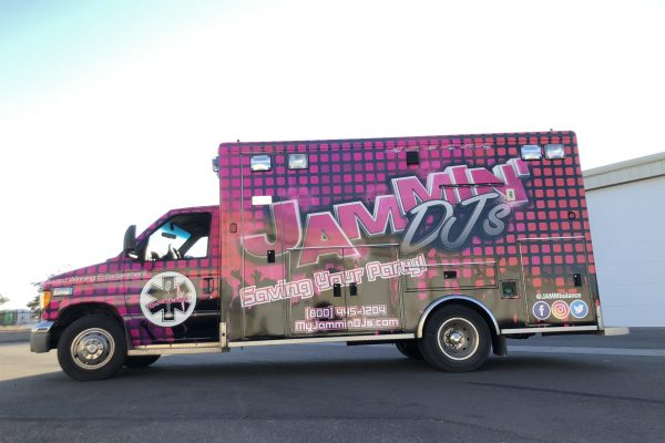 Custom graphics on a pink car wrap