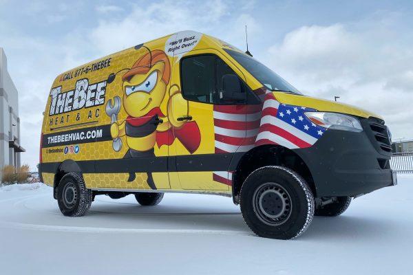Custom yellow wrap on work van