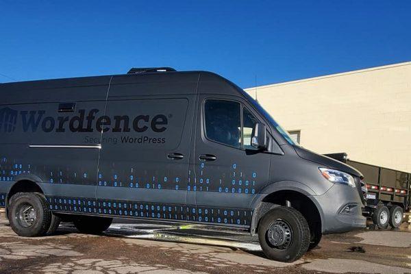 Commercial van with custom black car warp