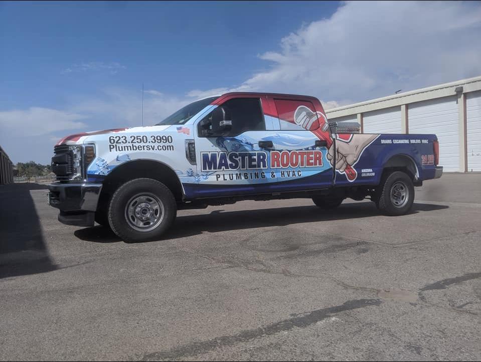 plumbing company uses car wrap advertising